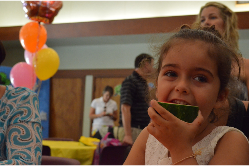 Lily Saba munches on some refreshing watermelon.