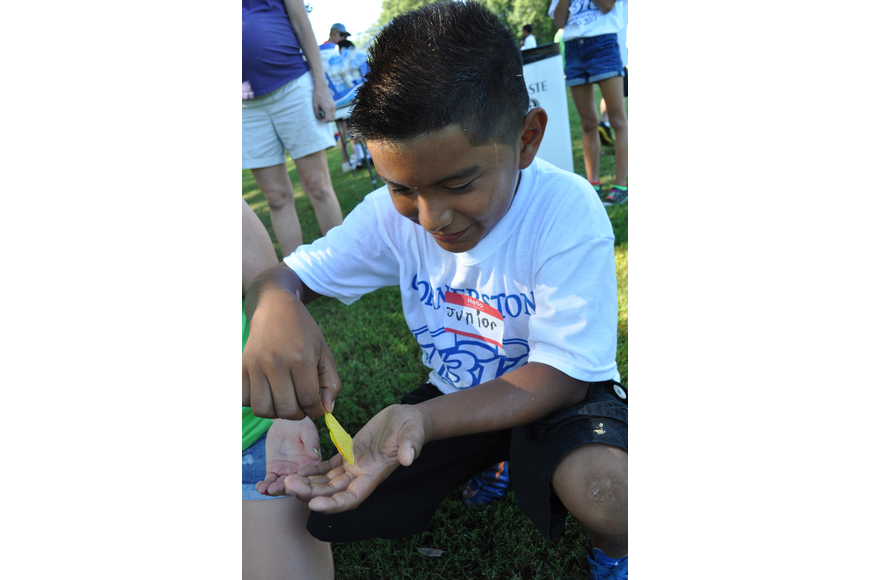Junior Hernandez finds a yellow butterfly during a water break.