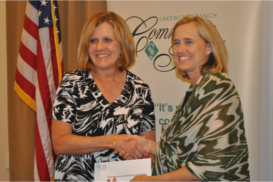 Monica Rice, a guidance counselor at B.D. Gullett Elementary School, accepted a grant from Jennifer Schembri of the Lakewood Ranch Community Fund.