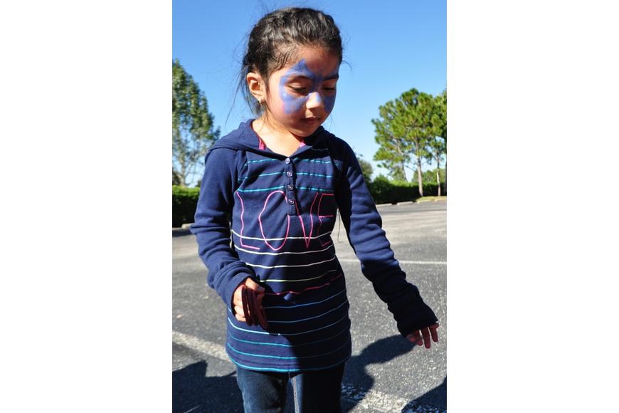 Gabriela Sandoval, 4, tried her hand at a game of ring toss.
