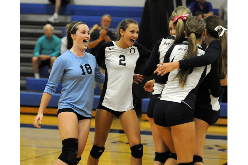 The ODA volleyball team celebrates after defeating Calvary Christian 3-1 in the Class 3A-Region 3 quarterfinals Oct. 29.