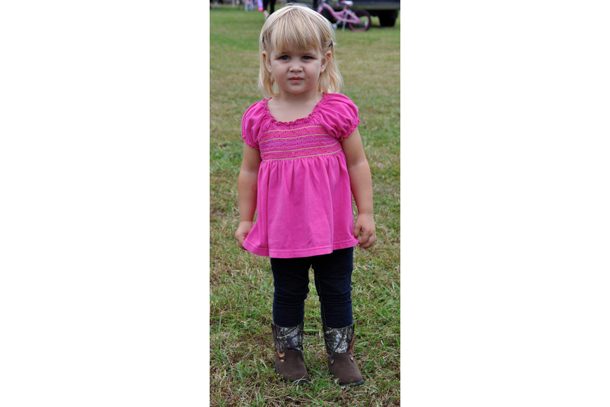 Lotus Burrow, 2, shows off her western wear.