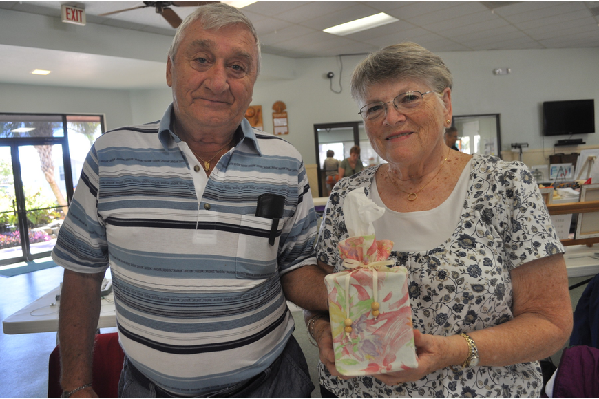 Gene Gelinas with his wife, Janet, who sewed the cover of a tissue box