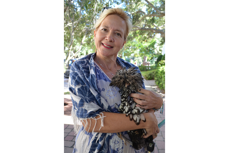 Wendy Fitzgerald brought her four-month-old Polish Bantam hen, Elvis to be blessed.