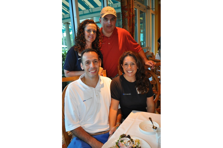 Hugo and Nattaly Perez, front, enjoyed dinner with Tina and Ken Wahlers, behind.