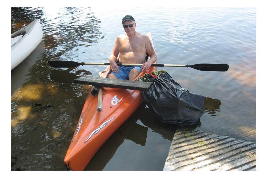 Volunteer Ron Piper collected trash by kayak.
