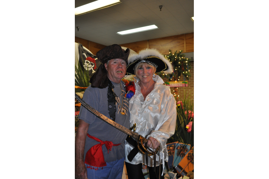 Bob Minehardt and Diane DeMont went in pirate garb for the