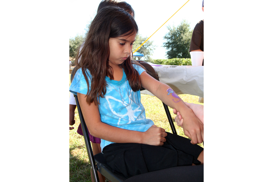 Eight-year-old Christina Aguero got a seahorse painted on her arm.