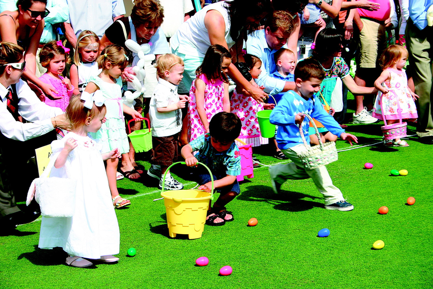 Children raced to fill their baskets with eggs in April at The Oaks Club's Easter celebration.