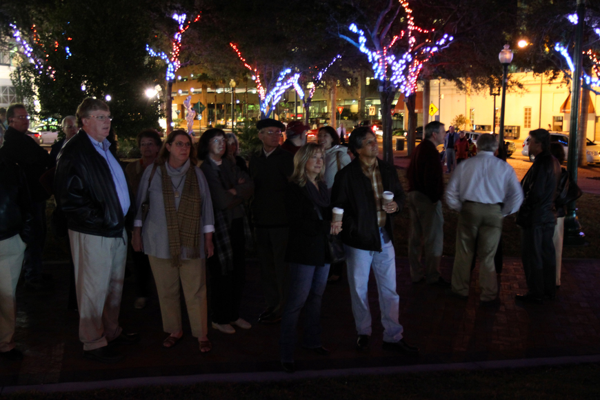 The crowd takes in all the changing colored lights in the trees of Five Points Selby Park on Friday night.