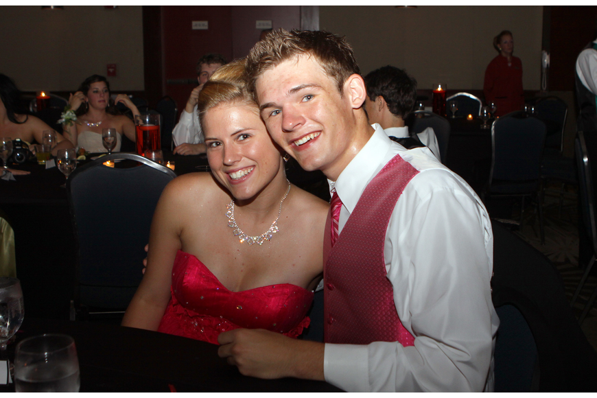 Ashley Profit and Austin Orr take a break from the dance floor to sit together at their table Saturday, May 14 at the Sarasota High School's prom at the Hyatt Regency.