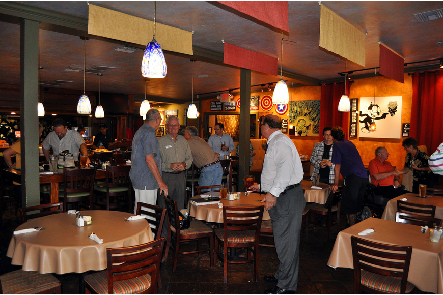 The Young Entrepreneurs of Sarasota chat with one another Tuesday, Sept. 6 at Clayton's Siesta Grille on Siesta Key.