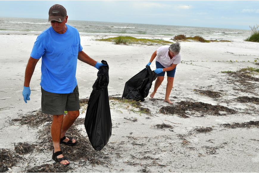 Brian and Lori Patti, while on vacation from AZ, joined the Barefoot Wine Beach Cleanup Thursday, Sept. 8, at Ted Sperling Park.