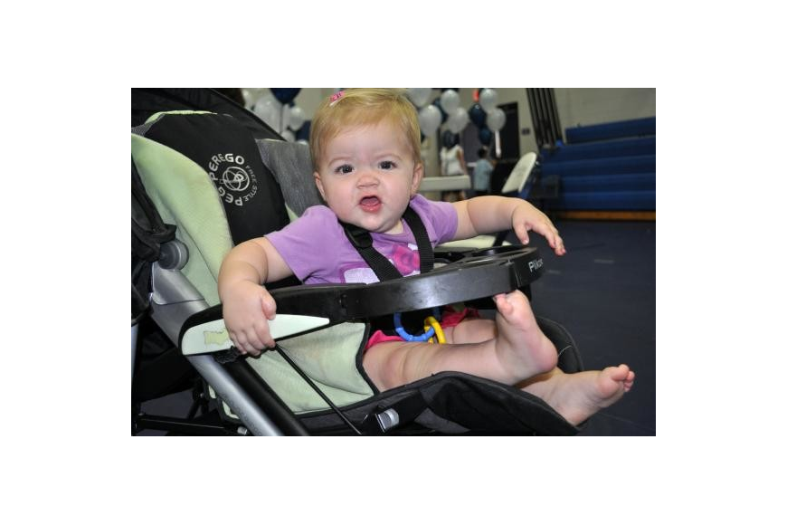 Ella Dyer, 11 months, had fun watching all of the people at Thunder Fun Day. Photo by Jen Blanco.