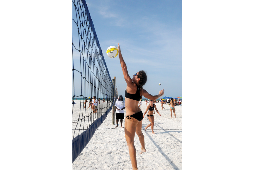 Danny Harrison spiked the ball during Fiesta on Siesta, which returned to the public beach April 16 for the third year in a row.
