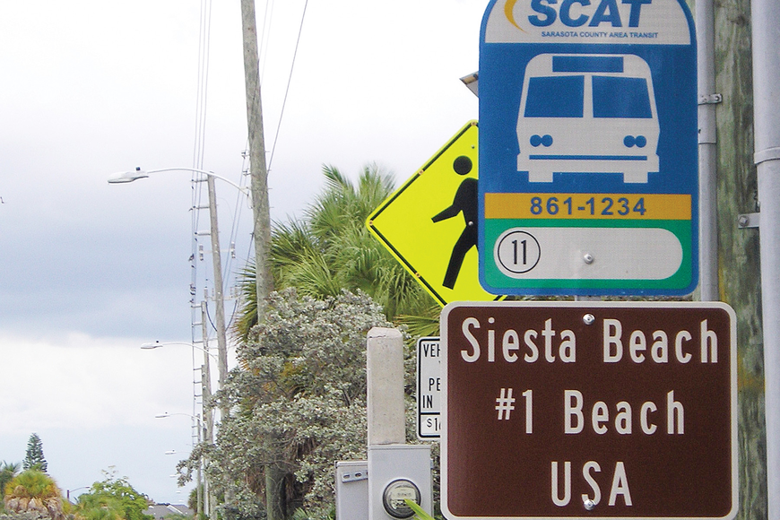 The No. 1 beach signs erected at county bus stops did not win rave reviews.