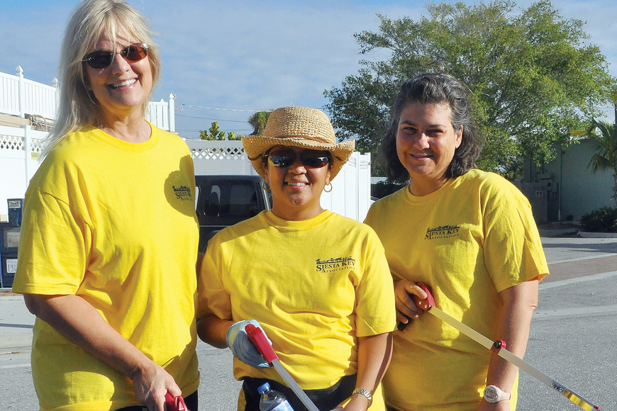 Catherine Luckner, Beverly Arias and Maria Shay helped clean up the Key during the quarterly Adopt-A-Road event.