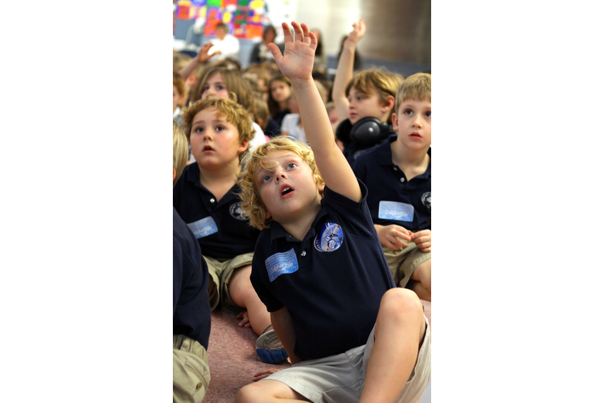 Tanner Luria, 6, raises his hand to ask Dan Strzempka a question, Friday, Jan. 20, at Out-of-Door Academy.