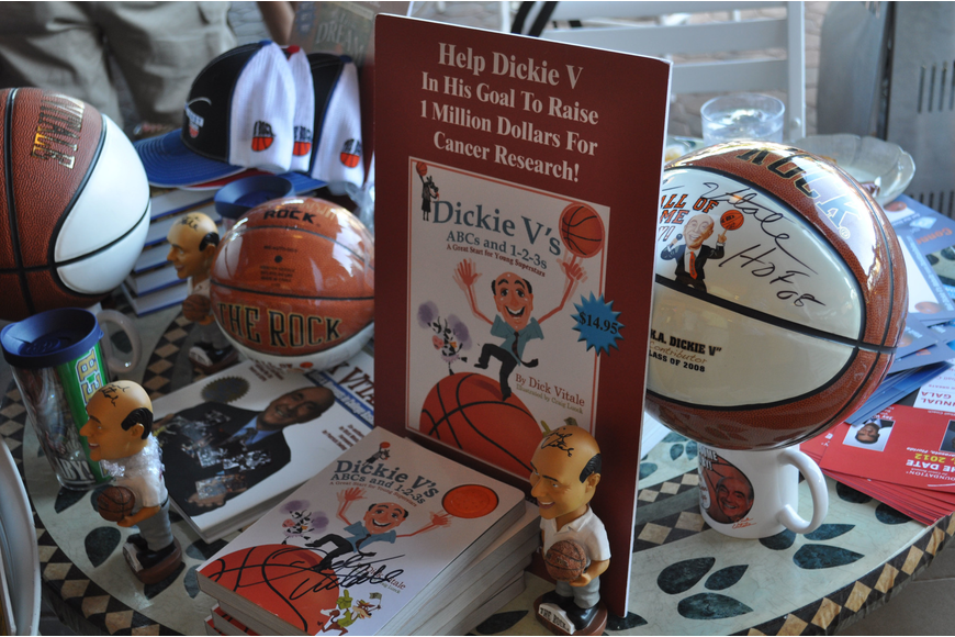 Dick Vitale sells autographed merchandise to help raise money for The V Foundation for Pediatric Cancer Research.