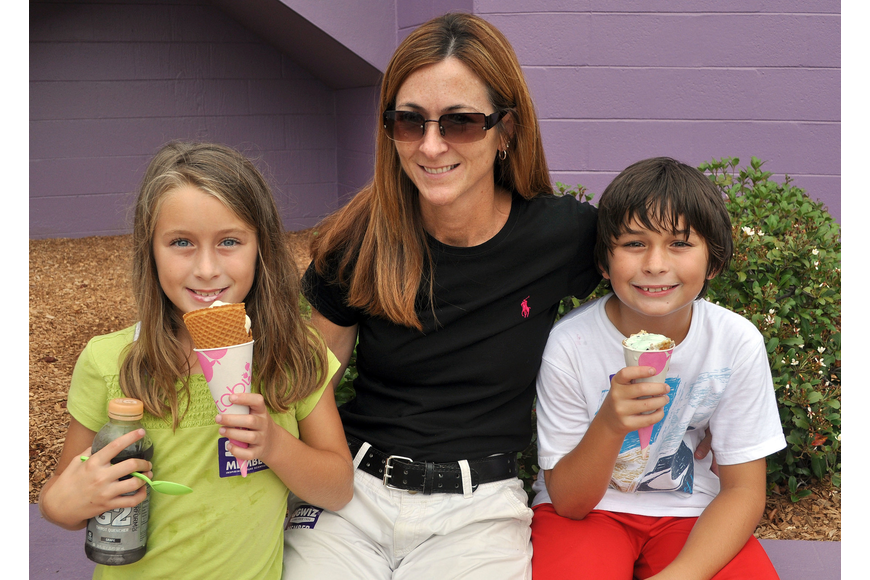 Lisa Hales poses with her twins, Caitlyn and Connor, 8, as they eat ice cream.
