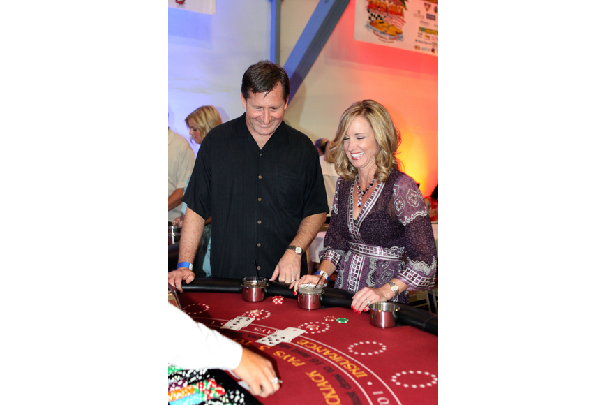 Peter Currin and Jennifer Cline have fun playing black jack, Saturday, June 23, at the Festival Kickoff Party for the 2012 Suncoast Super Boat Grand Prix Festival at the Sarasota Municipal Auditorium.
