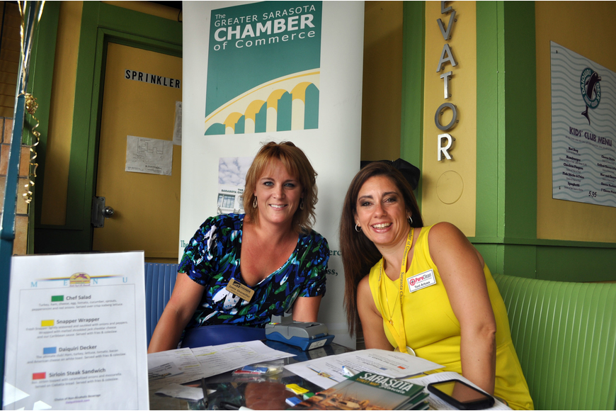 Jamie Overmiller and Tori Artusa checked people into the SCC Power Hour Lunch, Wednesday, Aug. 22, at the Daiquiri Deck on St. Armands.