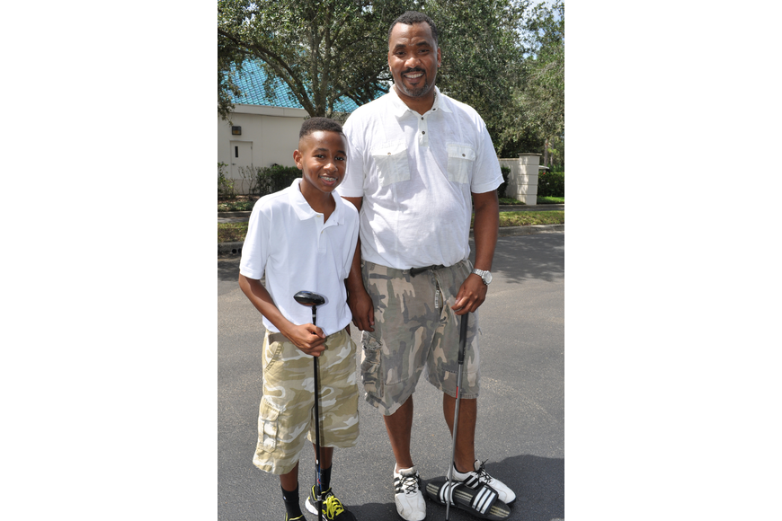 Myles Cowart, 12, golfed with his dad, Marcus.