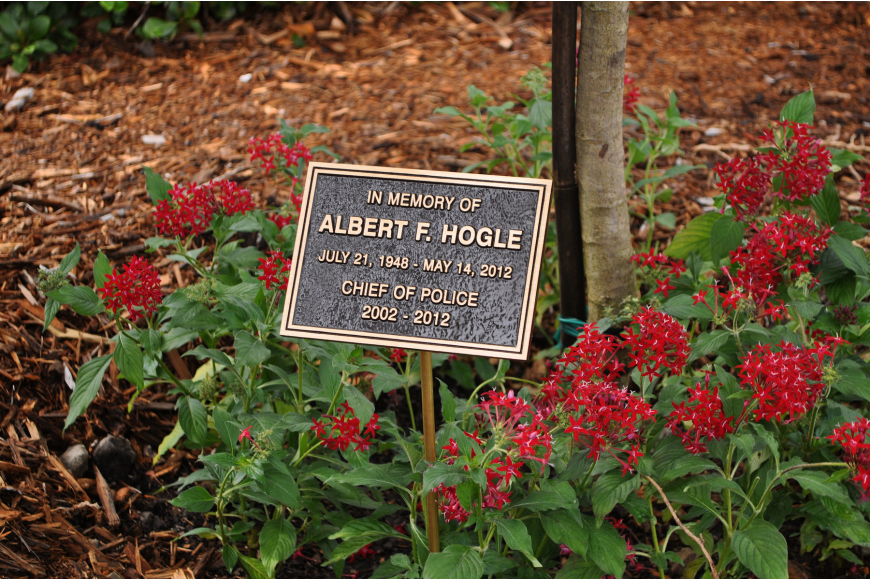 The plaque will be cemented into the ground in front of the cassia fistula tree that was planted in honor of Police Chief Al Hogle.