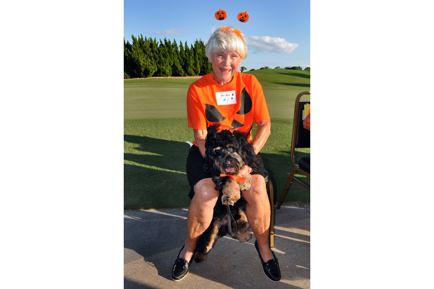 Doris Collins and her dog Bailey, 2, got into the pumpkin spirit of Halloween Monday, Oct. 22, for the 2nd annual Halloween Doggie Parade at Stoneybrook Golf and Country Club in Palmer Ranch.