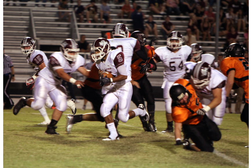 Jaden Adams, No. 5, runs down the field with the ball.