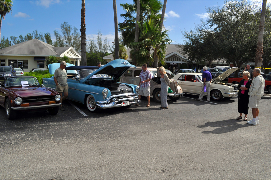 People have fun looking at antique cars in the Centre Shops parking lot.