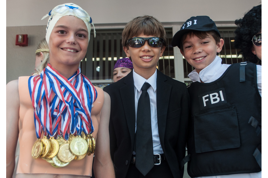 Connor Krug dressed as Olympic Swimmer Michael Phelps, Hayden Bizick came as Men in Black and Tyler Beasley was the FBI.