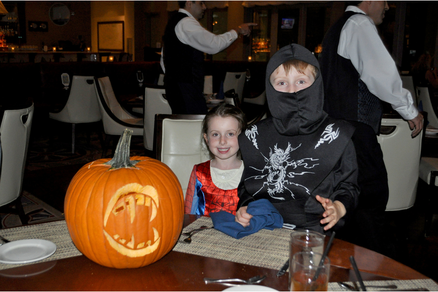 Young guests Katherine and George sit with their contest-winning pumpkin.