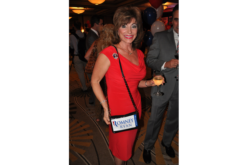 Holly Derrick shows off her purse that she decorated with a Romney Ryan sticker.