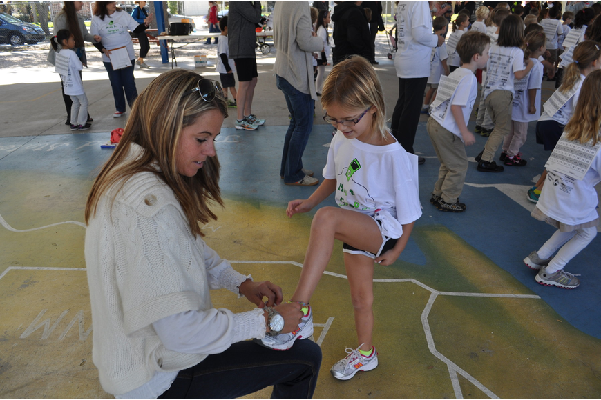 Brooke Hann helps her daughter, Saylor, tie her shoes.