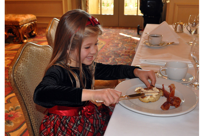 Tiffany McCoy, 7, butters her mitten-shaped French toast.