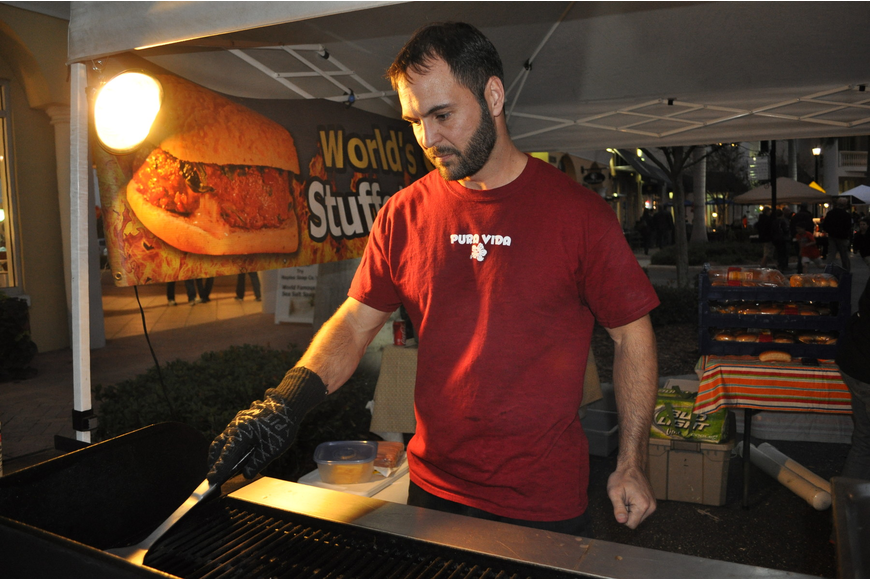 Matt Holt served hamburgers from Full Belly Stuffed Burgers.