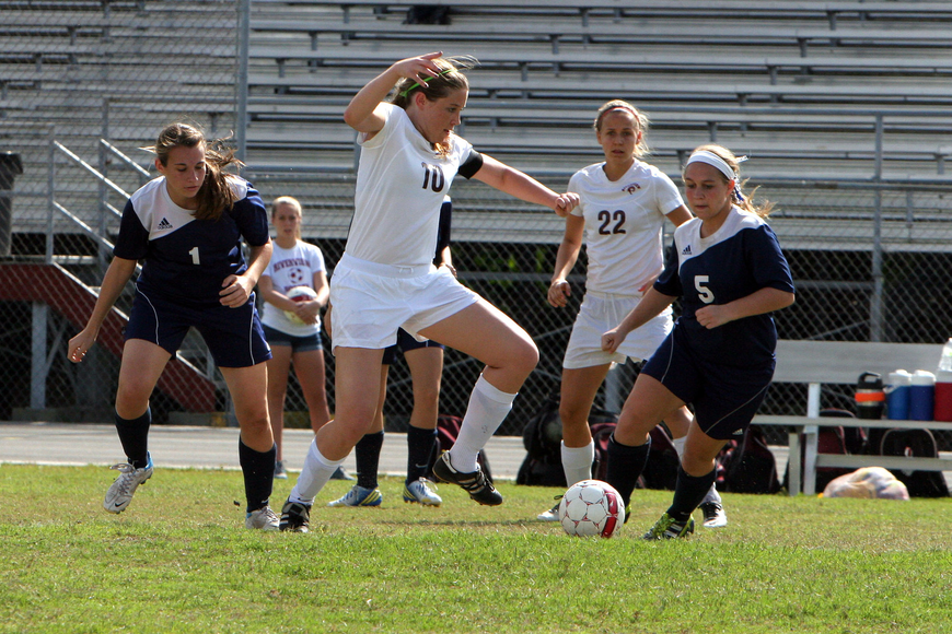 Riverview's Allison Jones, No. 10, works to get the ball away from North Port.