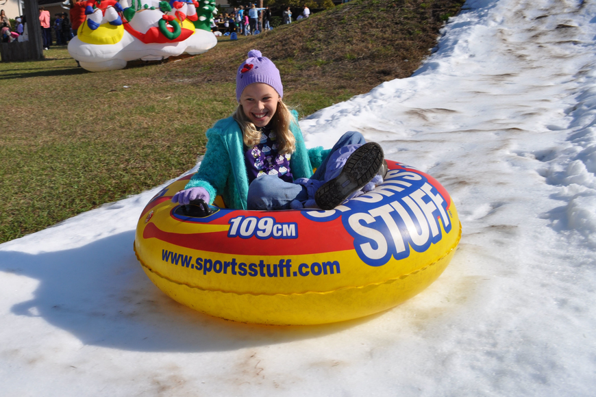 Christa Harding, 10, smiles all the way down the hill.