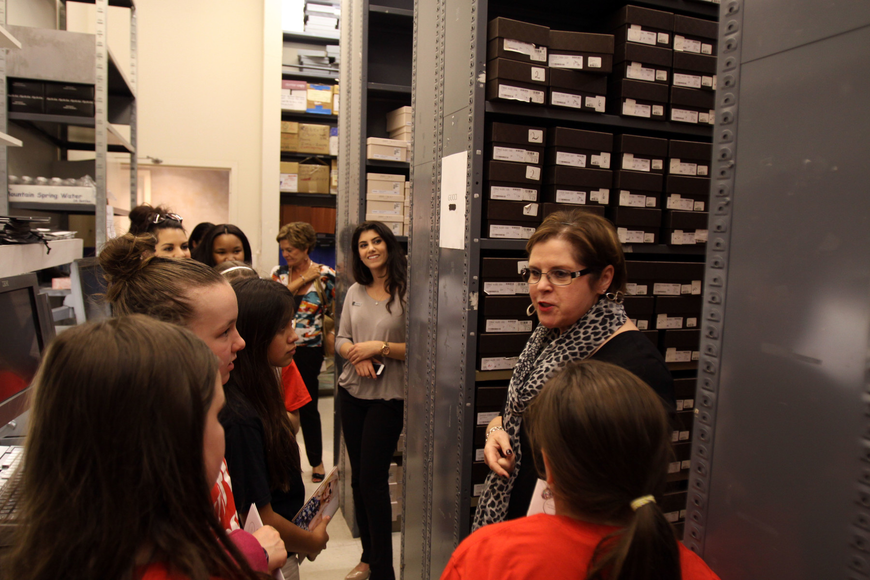 Susan Brothers shows the girls the shoe stock room.