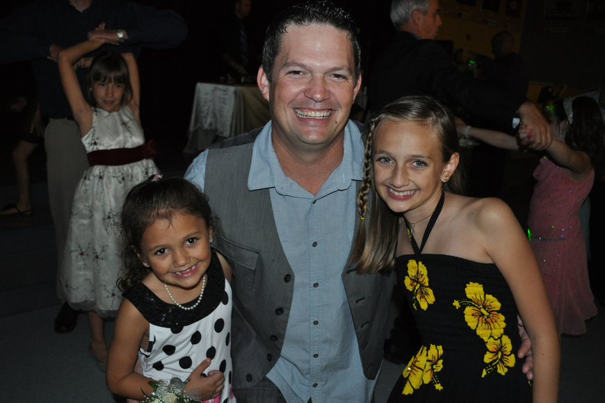 Duane Curry danced the night away with his daughters, Samantha, left, and Ciara, right.