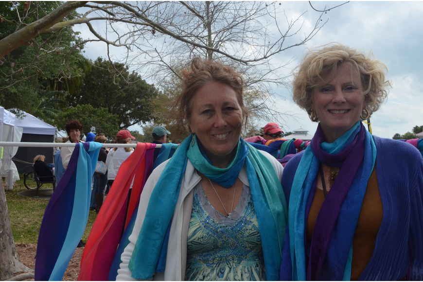 Artisan Anna Champaign hand paints silk scarves. She stands with customer Jane Hamlin.
