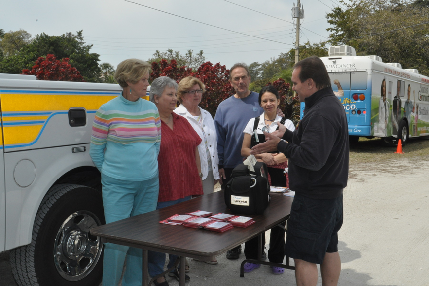 Lt. Rocky Parker, far right, demonstrates how a cardiac monitor works to Betty Jo Haas, Penny Ellis, Connie Haas and Vic and Maria Levine.