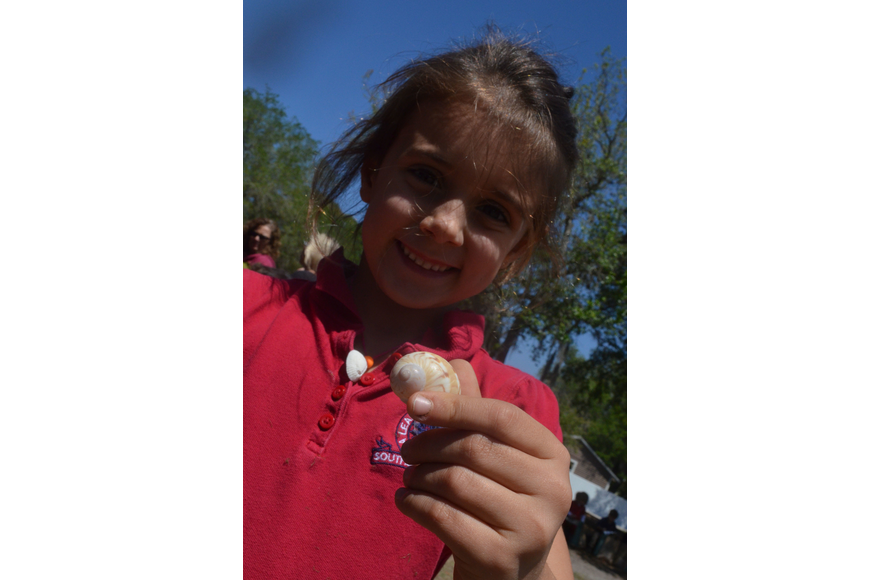 Kindergartner Rowan Van Dender shows off a shell from the Mote Marine Aquarium zone.