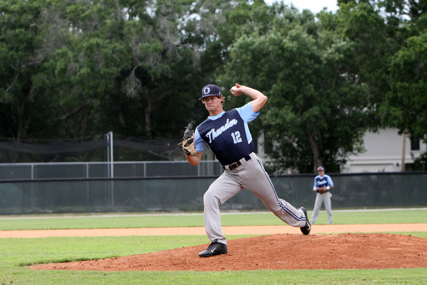 Out-of-Door Academy's Austin Hoppe, No. 12, pitches.