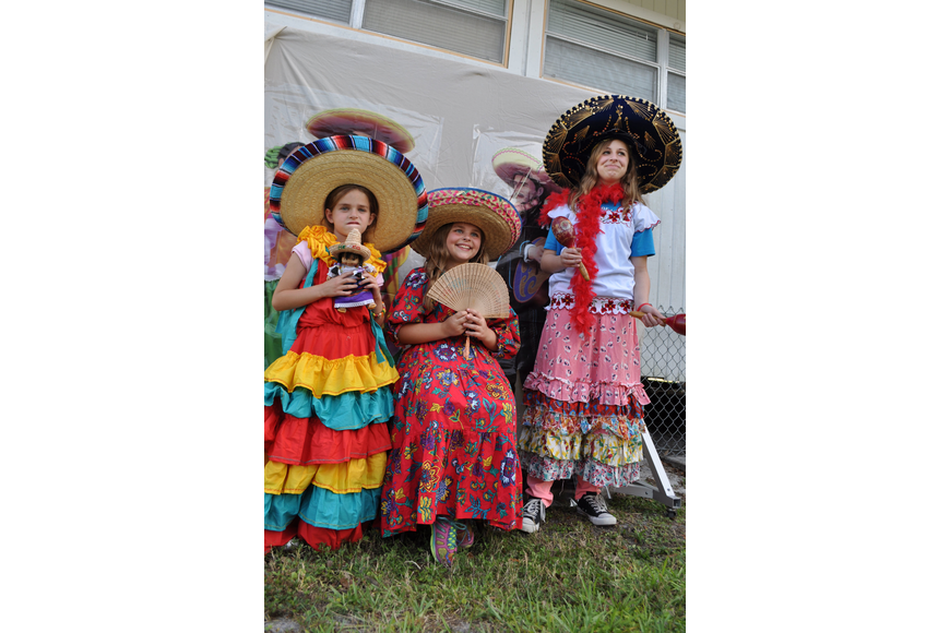 Sisters Emma, Lauren and Kate Andrews tried on festive Mexican garb for a photo session.