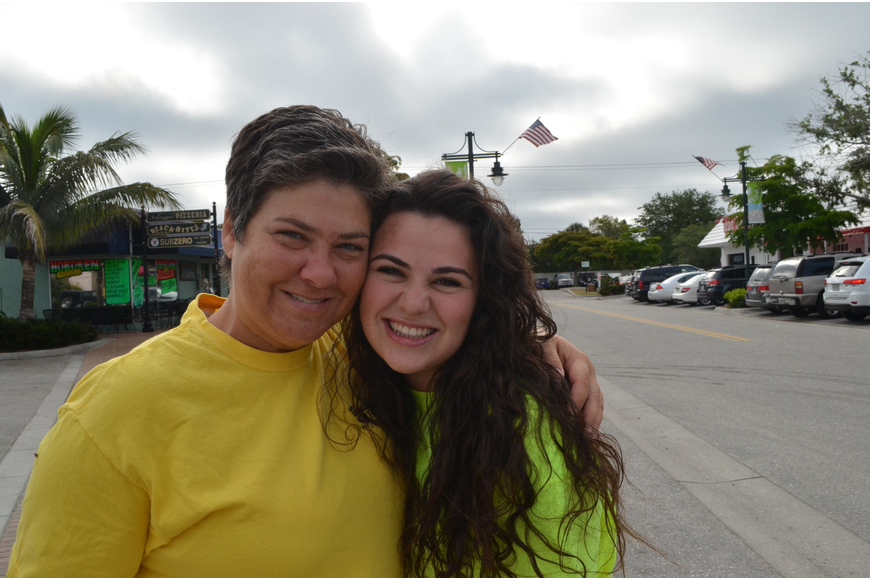 Maria Shay hugs her niece Alexandra Krusinski at the Adopt-a-Road Pickup Saturday, June1. Her niece is visiting from New Jersey.