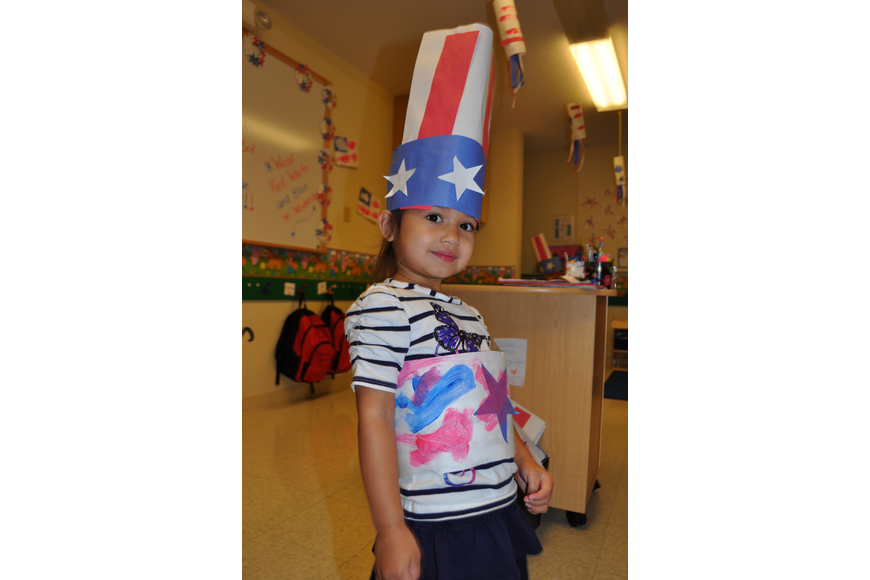 Three-year-old Layla Bianes wears an Uncle Sam-inspired hat.