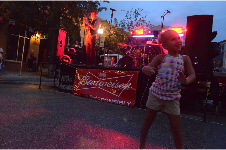 Kirsten Soler, 5, dances to music at the block party.