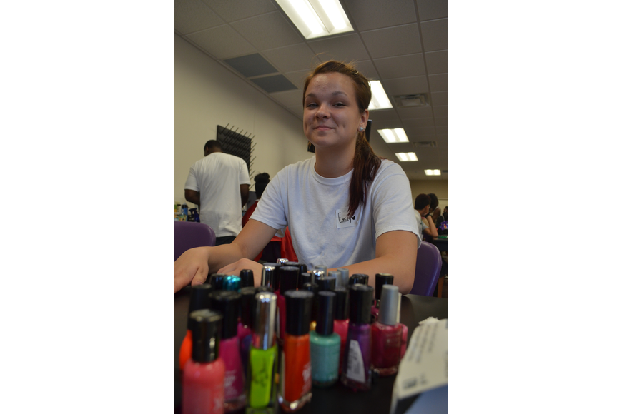 Fifteen-year-old Emily Alday gets a manicure during the Fifth Annual Day of Hope.